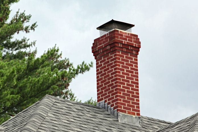 Painting-a-Chimney-Cap
